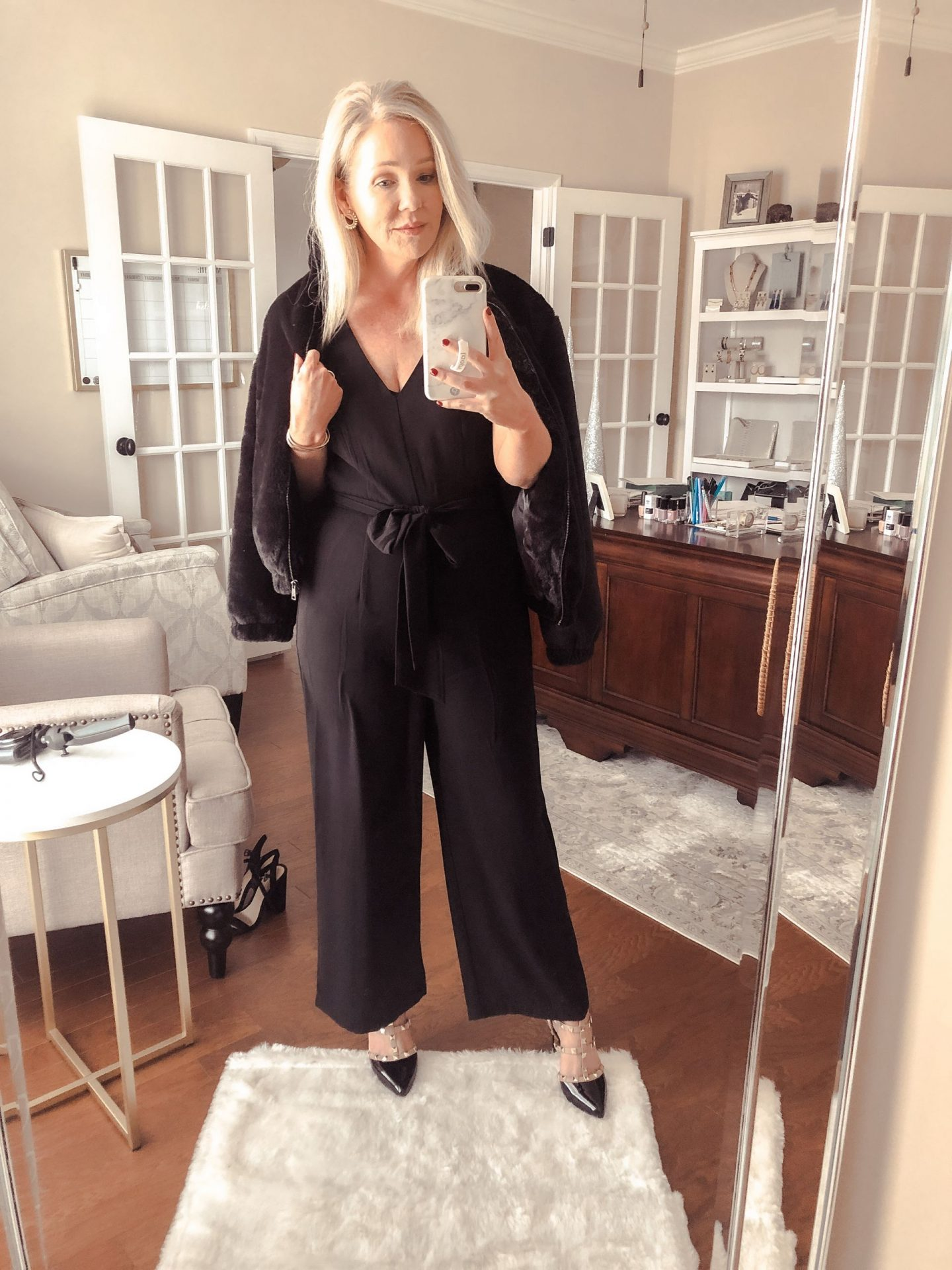 black jumpsuit faux fur jacket